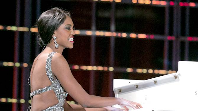 """This photo courtesy Miss America Organization shows Miss North Dakota Rosie Sauvageau took top honors Thursday, Jan. 10, 2013, after her piano and vocal rendition of """"To Make You Feel My Love."""" The 24-year-old from Fargo, N.D., will take home a $2,000 Amway scholarship from the competition at Planet Hollywood resort in Las Vegas. (AP Photo/Miss America Organization)"""