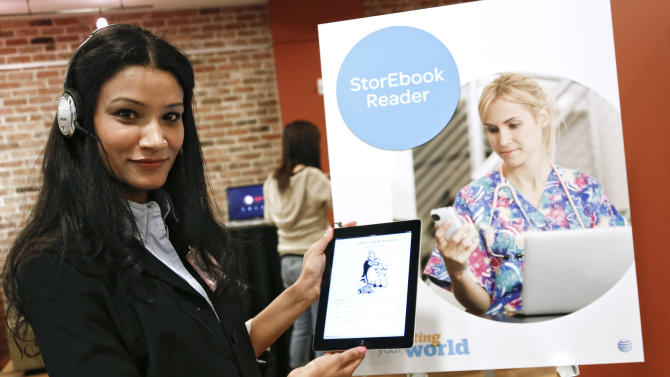 IMAGE DISTRIBUTED FOR AT&T - Taniya Mishra, a researcher with AT&T Labs, demos the StorEbook text-to-speech app at the AT&T Innovation Showcase event on Wednesday, April 4, 2013, in New York City. The StorEbook Reader app is a prototype that reads childrens' stories expressively in character-appropriate voices. (Brian Ach /AP Images for AT&T)