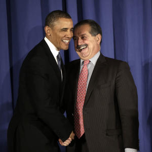 President Barack Obama, left, is introduced by Andrew N. Liveris, right, President, Chairman and Chief Executive Officer of The Dow Chemical Company, before Obama spoke at the Business Council dinner in Washington, Wednesday, Feb. 27, 2013.(AP Photo/Pablo Martinez Monsivais)