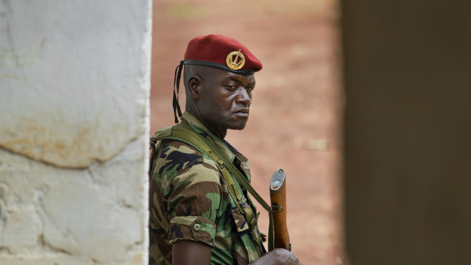 A soldier from the Central African Republic stands guard at a building used for joint meetings between them and U.S. Army special forces, in Obo, Central African Republic, Sunday, April 29, 2012. Obo was the first place in the Central African Republic that Joseph Kony's Lord's Resistance Army (LRA) attacked in 2008 and today it's one of four forward operating locations where U.S. special forces have paired up with local troops and Ugandan soldiers to seek out Kony. (AP Photo/Ben Curtis)