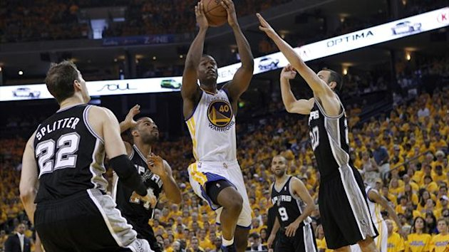 Golden State Warriors' Harrison Barnes drives to the basket against San Antonio Spurs' Tiago Splitter (L), Gary Neal (2nd L), Tony Parker and Manu Ginobili during Game 4 of their NBA Western Conference semi-final playoff basketball game (Reuters)