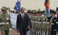President Barack Obama reviews the troops with Federation Guard Maj. John Cottis, left, during an official arrival ceremony at Parliament House, Wednesday, Nov. 16, 2011, in Canberra, Australia. (AP Photo/Susan Walsh)