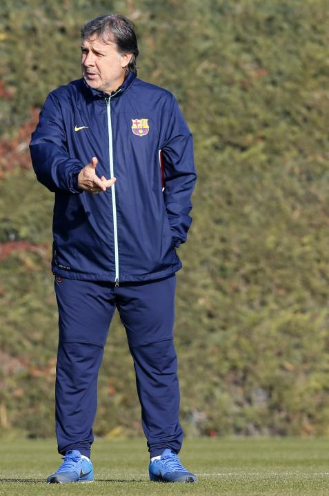 FC Barcelona's coach GerardoTata Martino gestures during a training session at Ciutat Esportiva Joan Gamper in Sant Joan Despi near Barcelona