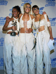 FILE - In this Sept. 7, 1995 file photo, the band TLC, from left, Rozanda &quot;Chilli&quot; Thomas, Tionne &quot;T-Boz&quot; Watkins and Lisa &quot;Left Eye&quot; Lopes, pose for photographers backstage at New York&#39;s Radio City Music Hall during the 12th Annual MTV Video Music Awards. TLC won in the Best R&B Video, Viewer&#39;s Choice and Best Video of the Year categories for &quot;Waterfalls.&quot; For R&B singer Tionne &quot;T-Boz&quot; Watkins, it has been a rocky road since the 2002 death of Lisa &quot;Left Eye&quot; Lopez. Now, she puts her life on display through her new reality show, &quot;Totally T-Boz,&quot; an hour-long, four-episode series that airs on cable network TLC on Tuesdays, beginning Jan. 1, 2013. (AP Photo/Paul Hurschmann, File)