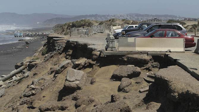 In this photo from Thursday, May 24, 2012, the parking lot at Ocean Beach is shown in San Francisco. In San Francisco, officials are mulling a significant retreat on its western flank, where the Great Highway is under assault from the Pacific Ocean. Right now, a beach parking lot that abuts the highway is crumbing into the sea just across the highway from the San Francisco Zoo. (AP Photo/Jeff Chiu)