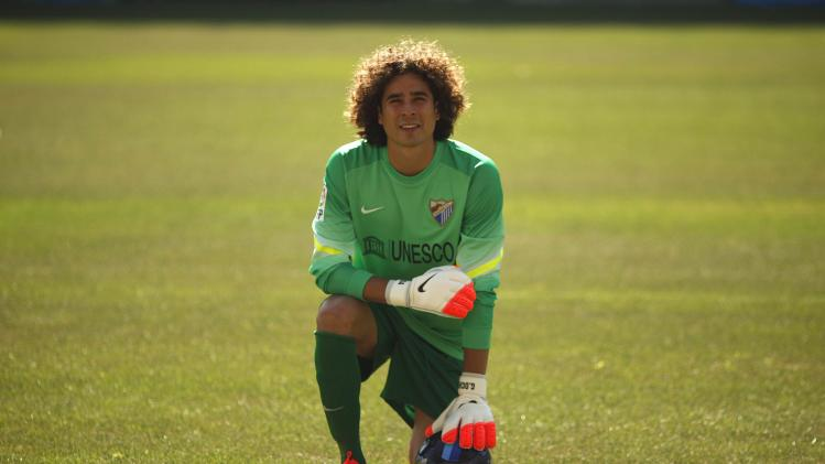 Malaga's newly signed goalkeeper Guillermo Ochoa from Mexico poses for the media during his official presentation at Rosaleda stadium, in Malaga
