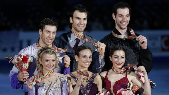Winners Meagan Duhamel, center foreground, Eric Radford, center back row, second-placed, Kirsten Moore-towers, foreground left, Dylan Moscovitch, left back row, of Canada and third-placed Marissa Castelli, foreground right, and Simon Shnapir of U.S. pose for photographers after the awarding ceremony of pairs event of the ISU Four Continents Figure Skating Championships in Osaka, western Japan, Sunday, Feb. 10, 2013. (AP Photo/Shizuo Kambayashi)