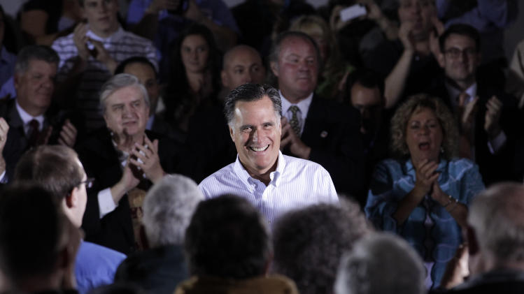 Republican presidential candidate, former Massachusetts Gov. Mitt Romney smiles during a town hall-style meeting in Aston, Pa., Monday, April 23, 2012. (AP Photo/Jae C. Hong)