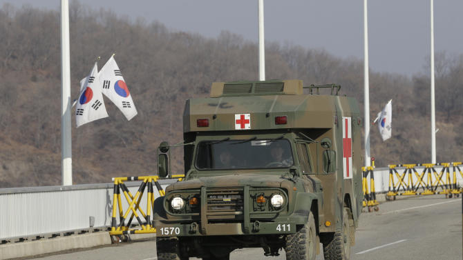 A South Korean military ambulance advances at barricaded Unification Bridge near the border village of Panmunjom, that has separated the two Koreas since the Korean War, in Paju, north of Seoul, South Korea, Wednesday, April 10, 2013. A few hundred South Korean managers, some wandering among quiet assembly lines, were all that remained Tuesday at the massive industrial park run by the rival Koreas after North Korea pulled its more than 50,000 workers from the complex. Other managers stuffed their cars full of finished goods before heading south across the Demilitarized Zone that divides the nations. (AP Photo/Lee Jin-man)