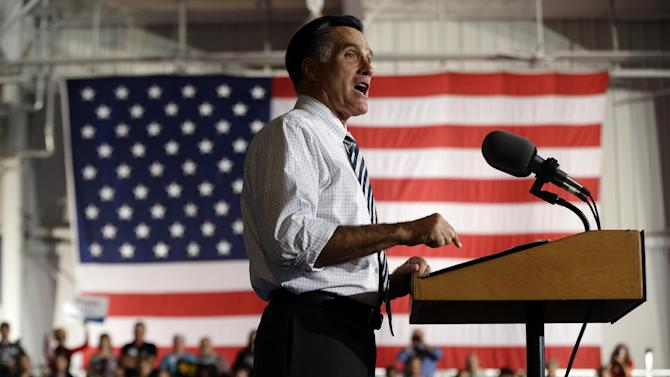 Republican presidential candidate, former Massachusetts Gov. Mitt Romney campaigns at Landmark Aviation at The Eastern Iowa Airport in Cedar Rapids, Iowa, Wednesday, Oct. 24, 2012. (AP Photo/Charles Dharapak)