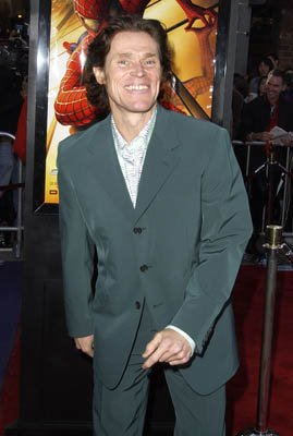 Willem Dafoe grins as if he'd make a good Joker at the LA premiere of Columbia Pictures' Spider-Man