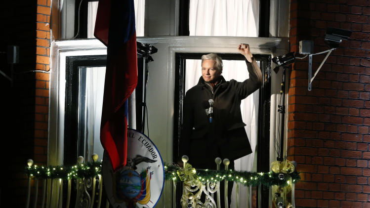 WikiLeaks founder Julian Assange waves to supporters as he prepares to make a statement to the media and supporters at a balcony of the  Ecuadorian Embassy in central London, Thursday, Dec. 20, 2012. Assange marked six months since he took refuge at the embassy on June 20 to avoid extradition to Sweden where he faces allegations of sex crimes, which he denies. (AP Photo/Lefteris Pitarakis)