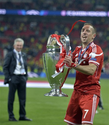 Bayern Munich's Franck Ribery of France lifts the trophy after winning the Champions League Final soccer match against Borussia Dortmund at Wembley Stadium in London, Saturday May 25, 2013
