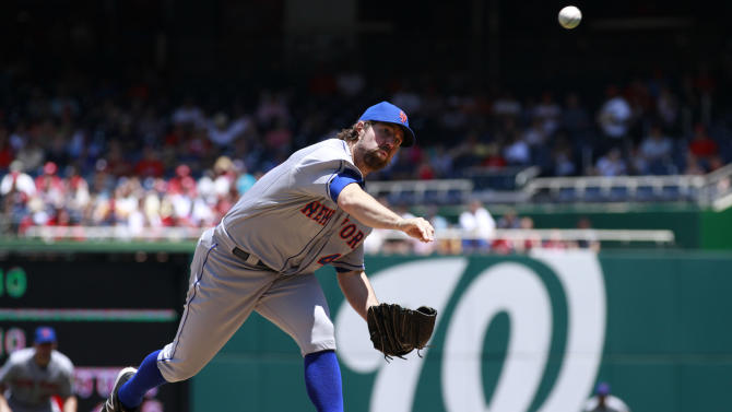 New York Mets starter R.A. Dickey pitches against the Washington Nationals during the first inning of a baseball game at Nationals Park in Washington, on Thursday, June 7, 2012. (AP Photo/Jacquelyn Martin)