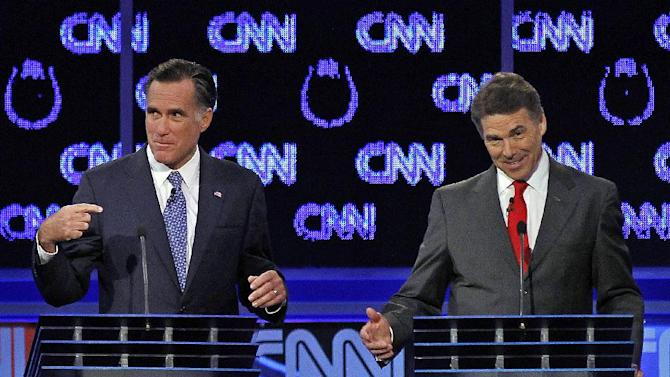 "FILE - In this Oct. 18, 2011, file photo Republican presidential candidates Mitt Romney and Rick Perry, right, spar during a Republican presidential debate in Las Vegas. Perry, still nursing wounds from his failed presidential campaign, did himself a world of good with his self-deprecating jokes at a dinner in Washington in March. First, he joked that his time as the GOP front-runner had been ""the three most exhilarating hours of my life."" Then he perfectly skewered Romney by quipping that during the GOP debates, he'd been tempted to turn to his rival and ask, ""Pardon me, do you have any Grey Poupon?"" (AP Photo/Chris Carlson, File)"