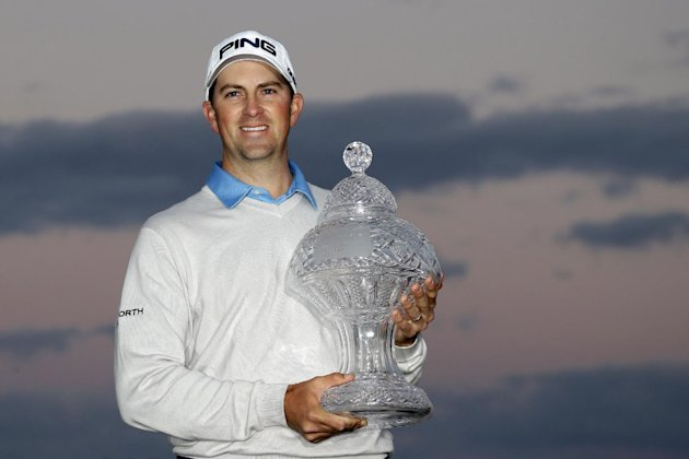 Michael Thompson holds the trophy after winning the Honda Classic golf tournament, Sunday, March 3, 2013 in Palm Beach Gardens, Fla. (AP Photo/Wilfredo Lee)