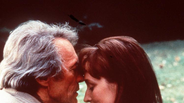 "This undated film image released by Warner Bros. shows Clint Eastwood, left, and actress Meryl Streep in a scene from. ""The Bridges of Madison County."" The book made into a film starring Meryl Streep and Clint Eastwood, is heading to Broadway as a musical. Producers said Thursday, June 6, 2013, the show, with songs by Jason Robert Brown and a book by Marsha Norman which debuts at the Williamstown Theatre Festival in Massachusetts this August, will land at the Gerald Schoenfeld Theater in January. (AP Photo/Warner Bros., file)"