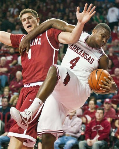 Cooper helps Alabama past Arkansas 79-68