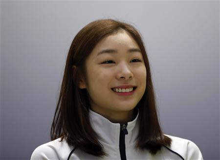 South Korean figure skater Kim Yuna attends a news conference ahead of the Sochi 2014 Winter Olympics, in Seoul