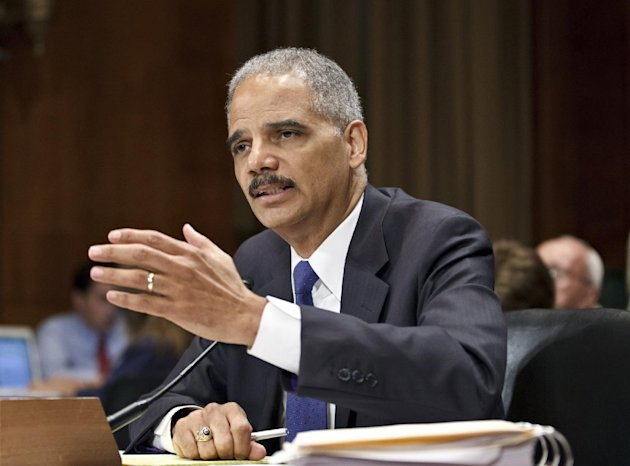 FILE - In this June 12, 2012 file photo, Attorney General Eric Holder testifies on Capitol Hill in Washington. In email exchanges with subordinates in February and March 2011, Attorney General Eric Holder and the department&#39;s second-highest official expressed growing concern that something might have gone wrong in a federal gun-smuggling probe called Operation Fast and Furious. (AP Photo/J. Scott Applewhite)