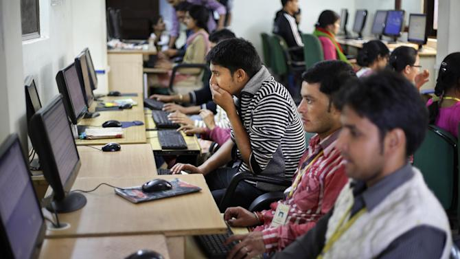 In this Aug. 23, 2012 photo, employees work on computers at the B2R center in Simayal, India. Before B2R arrived in Simayal, local women had little option but to marry right out of school, and educated young men had to travel far to seek respectable jobs. (AP Photo/Saurabh Das)