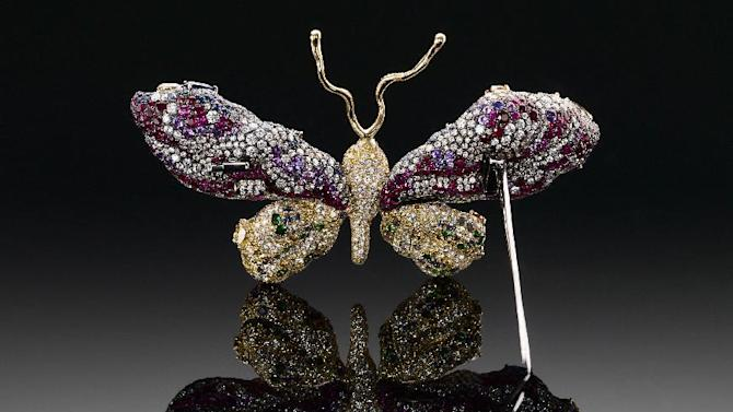 "This undated handout photo provided by The Smithsonian's National Museum of Natural History shows one side of the ""Royal Butterfly Brooch"" . The museum is unveiling the newest addition to its famous gem collection with a butterfly brooch made of 2,300 gems. The ""Royal Butterfly Brooch"" was created in 2009 by Taiwanese jewelry artist Cindy Chao. She is donating the piece to the museum, making it the first Taiwanese-designed item in the National Gem Collection. It goes on display Wednesday. The Royal Butterfly is composed of 2,328 gems, totaling 77 carats. It includes colored and color-changing sapphires and diamonds, rubies and tsavorite garnets. The centerpieces of the butterfly's wings are four large-faceted diamond slices. (AP Photo/Smithsonian's National Museum of Natural History)"