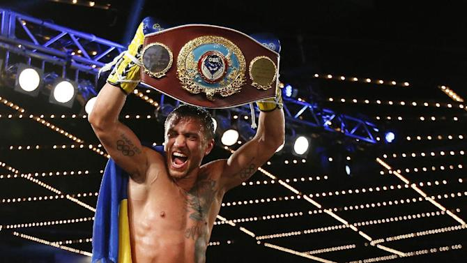 Boxing - Lomachenko knocks out Martinez for historic 2nd title