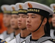 Chinese sailors form an honour guard as they wait for the arrival of Singapore Prime Minister Lee Hsien Loong at the Great Hall of the People in Beijing on September 6. Chinese Vice President Xi Jinping missed Lee's visit, along with several other scheduled meetings, giving rise to speculation over his health