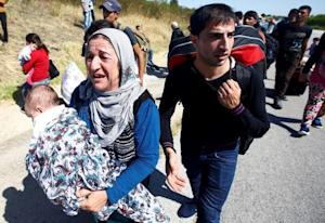 Syrian migrants walk towards the Greece border on a …