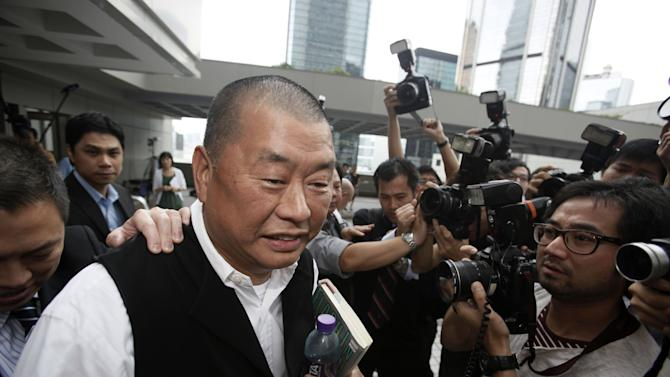 FILE - In this June 23, 2009 file photo, media magnate Jimmy Lai appears in a court in Hong Kong after a Chinese man was convicted in Hong Kong for allegedly planning to shoot two prominent pro-democracy figures, Lai and veteran politician Martin Lee, in the territory. Hong Kong anti-corruption police on Thursday, Thursday, Aug. 28, 2014, searched the homes of Lai who is an outspoken critic of Beijing and a pro-democracy legislator after receiving a complaint alleging that lawmakers had taken bribes. (AP Photo/Kin Cheung, File)