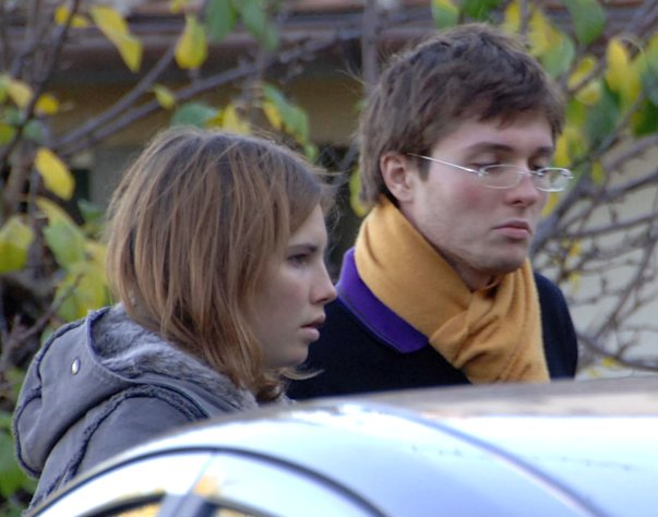FILE - This Nov. 2, 2007 file photo shows Amanda Marie Knox, of the U.S., left, and her then-boyfriend Raffaele Sollecito, of Italy, outside the rented house where 21-year-old British student Meredith Kercher was found dead in Perugia, Italy. Sollecito, whose budding love affair with American exchange student Amanda Knox helped land him in an Italian prison for four years, maintains the couple's innocence in a new book but acknowledges that their sometimes bizarre behavior after her roommate's killing gave police reason for suspicion. (AP Photo/Stefano Medici, File)