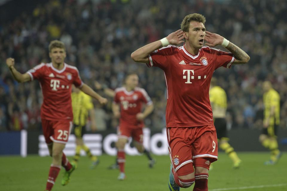 Bayern's Mario Mandzukic of Croatia celebrates scoring, during the Champions League Final soccer match between  Borussia Dortmund and Bayern Munich at Wembley Stadium in London, Saturday May 25, 2013. (AP Photo/Martin Meissner)