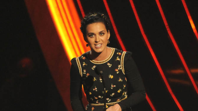 Katy Perry accepts the award for favorite pop artist at the People's Choice Awards at the Nokia Theatre on Wednesday Jan. 9, 2013, in Los Angeles. (Photo by Chris Pizzello/Invision/AP)