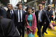 <p>Myanmar pro-democracy leader Aung San Suu Kyi (C) is surrounded by Pascal Canfin (2nd L) , French Minister Delegate for Development as she arrives at the train station gare du Nord in Paris.</p>