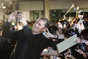 "Actor Wentworth Miller takes a picture with fans at the ""Resident Evil: Afterlife 3D"" Tokyo premiere"