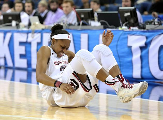 South Carolina guard Tiffany Mitchell (25) reacts after an injury in the first half  of a quarterfinal NCAA college basketball game against Georgia in the women's Southeastern Conference, Friday,