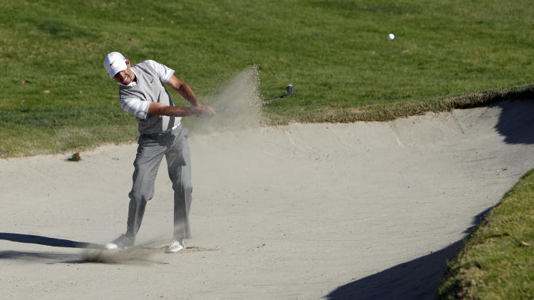 Charl Schwartzel, of South Africa, hits from the bunker on the 10th green in the second round of the Northern Trust Open golf tournament at Riviera Country Club in the Pacific Palisades area of Los Angeles Friday, Feb. 15, 2013. (AP Photo/Reed Saxon)
