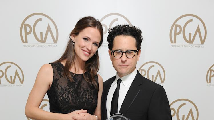Jennifer Garner, left, and J.J. Abrams are seen backstage at the 24th Annual Producers Guild (PGA) Awards at the Beverly Hilton Hotel on Saturday Jan. 26, 2013, in Beverly Hills, Calif. (Photo by Jordan Strauss/Invision for Producers Guild/AP Images)