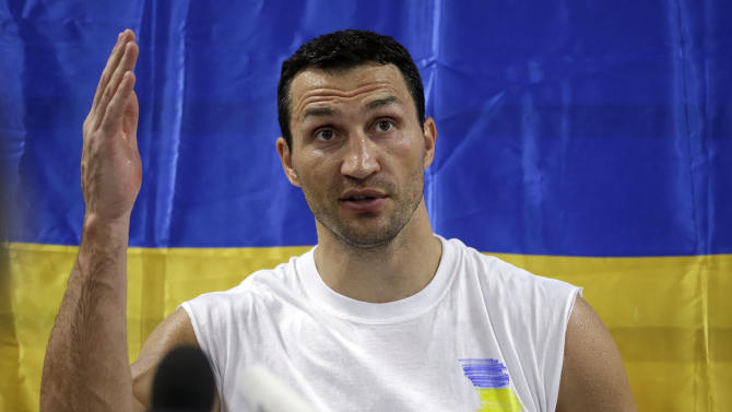 Undefeated heavyweight boxing champion Wladimir Klitschko, of Ukraine, speaks about the political situation in Ukraine during a news conference at the Lucky Street Boxing Gym, Thursday, March 20, 2014, in Hollywood, Fla. Klitschko is preparing for his upcoming fight April 26 against Alex Leapai in Germany. (AP Photo/Lynne Sladky)