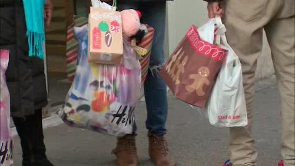 Holiday shopping in full swing, but people spending less