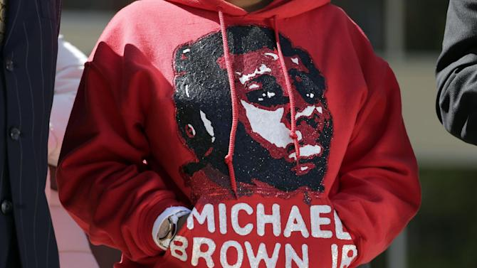 FILE - In this April 23, 2015 file photo, Lesley McSpadden, the mother of Michael Brown, wears a sweatshirt remembering her son during a news conference in Clayton, Mo. A majority of blacks in the U.S., more than three out of five, say they or a family member have personal experience with being treated unfairly by the police, and their race is the reason why. The parents of Michael Brown filed a wrongful-death lawsuit Thursday against the city of Ferguson, Mo., over the fatal shooting of their son by a white police officer, a confrontation that sparked a protest movement across the U.S. (AP Photo/Jeff Roberson, File)