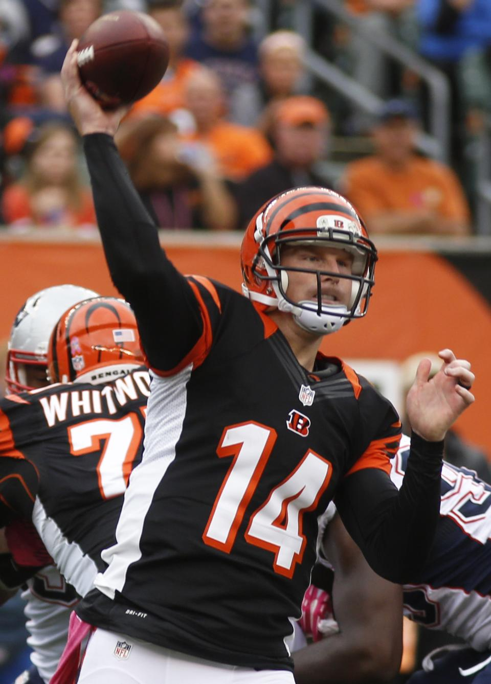 Cincinnati Bengals quarterback Andy Dalton passes against the New England Patriots in the first half of an NFL football game on Sunday, Oct. 6, 2013, in Cincinnati. (AP Photo/David Kohl)