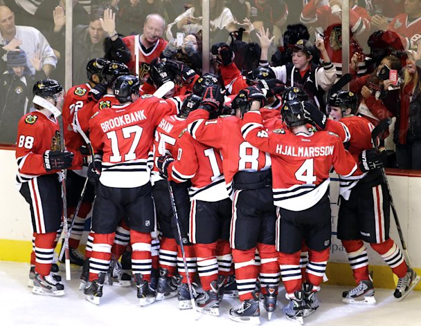 Chicago Blackhawks&#39; Brent Seabrook (7) celebrates with teammates after scoring his game-winning goal during the overtime of an NHL hockey game against the Columbus Blue Jackets in Chicago, Friday, March 1, 2013. The Blackhawks won 4-3. (AP Photo/Nam Y. Huh)