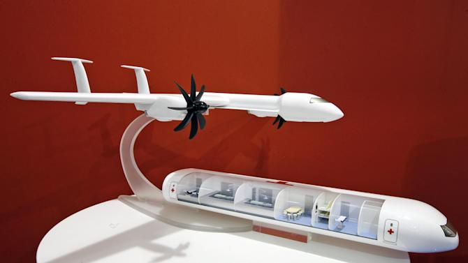 The Bee-Plane model with a hospital that could be dropped off in a crisis zone and picked up weeks later is displayed during the 50th Paris Air Show at Le Bourget airport, north of Paris, Thursday, June 20, 2013. The concept revolves around a wing that can fly on its own or with the fuselage where the cabin is attached. (AP Photo/Francois Mori)