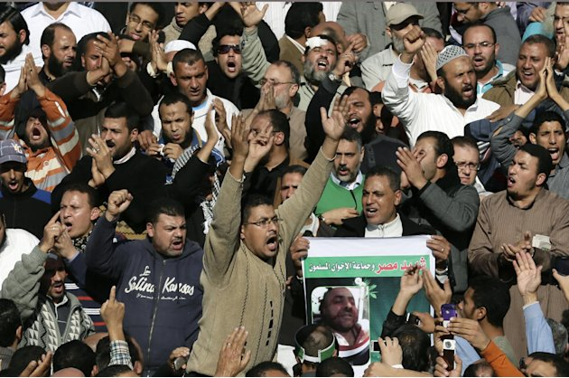 Supporters of the Muslim Brotherhood and Egyptian President Mohammed Morsi, chant slogans during the funeral of three victims who were killed during Wednesday's clashes outside Al Azhar mosque, the hi