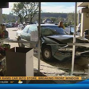 Driver rams car into store, breaking front window