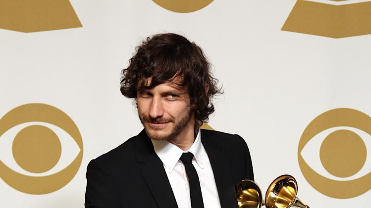 "Gotye poses backstage with the awards for best pop duo/group performance of the year and record of the year for ""Somebody That I Used to Know"" at the 55th annual Grammy Awards on Sunday, Feb. 10, 2013, in Los Angeles. (Photo by Matt Sayles/Invision/AP)"