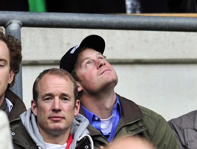 Prince Harry attends the Six Nations International rugby union match between England and Ireland at Twickenham Stadium in south-west London, England, on March 17, 2012. AFP PHOTO/GLYN KIRK (Photo cred