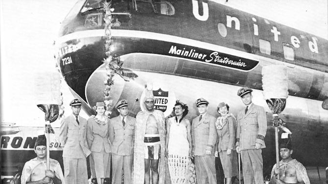 In this Oct. 9, 1950 photo provided by his family, Ron Akana, top row at left, stands at a ceremony with crew mates and the Aloha Week king and queen in Honolulu honoring United Airlines' inaugural flight to Los Angeles. Akana, 83, worked his last route over the weekend on a United Airlines flight from Denver to Kauai, ending his career in the state where it began.  Hawaii, however, wasn't his final stop. His destination is retirement in Boulder, Colo., where he has been living since 2002 to be closer to his grandchildren. He spent his first few days of retirement writing thank-you notes to well-wishers.  Guinness World Records sent Akana a plaque recognizing him as the longest-serving flight attendant. He's been told he'll appear in the record book in October.  (AP Photo/Courtesy of Jean Akana-Lewis)