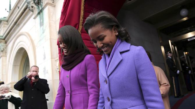 President Barack Obama's daughters Malia Obama,left, and Sasha Obama arrive on the West Front of the Capitol in Washington, Monday, Jan. 21, 2013, for the Presidential Barack Obama's ceremonial swearing-in ceremony during the 57th Presidential Inauguration.  (AP Photo/Win McNamee, Pool)